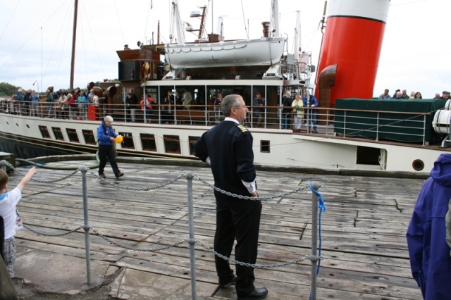 Harbour Master Peter Bates (foreground) monitors the safe berthing of the Waverley