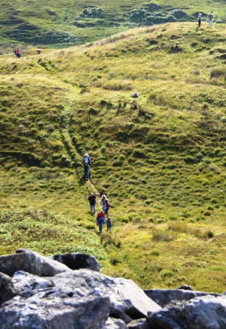 Local people make their way to the summit of Dunskeig Hill