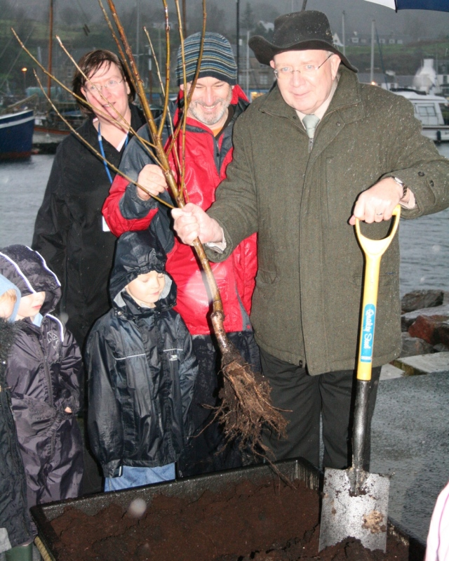 Mike Russell MSP plants the first tree